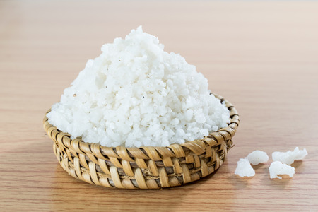 Sea salt on bamboo wickerwork Stock Photo
