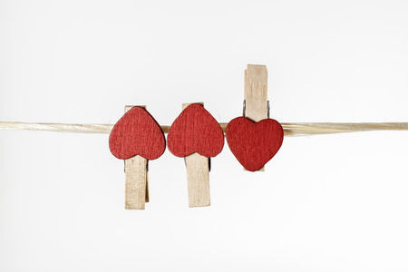 clothes pins: clothes pins with small hearts on white backgroud