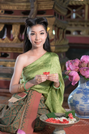 Women in Thai traditional dress at the old temple in Ayutthaya.