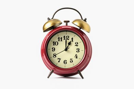 1:00 または pm を示すレトロな時計のイメージ。