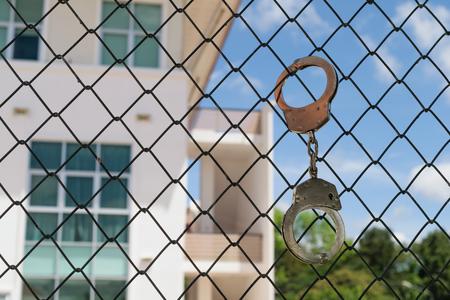 jailbreak: A shackle on the prison door Stock Photo