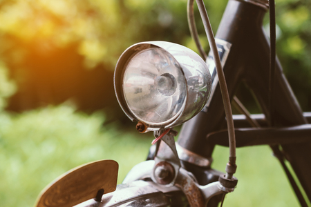 Headlight of old vintage bike  the garden  in vintage tone