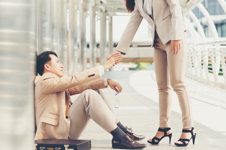 Business woman standing hand to help male businessman,Consultation and assistance,team work.