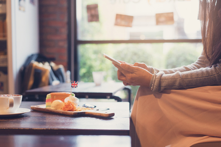 women use smartphone during in the cafe ,relax time