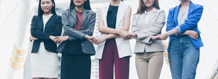 Group of business women holding hands support team. Coordinating of business unity in order to succeed in business,cooperation and teamwork business concept .panoramic banner Banque d'images