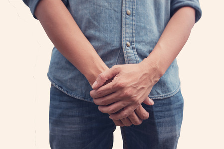 Man Covering His Crotch on  isolated background with clipping path