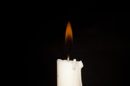 candle isolated on a black background