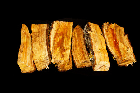 firewood isolated on black background