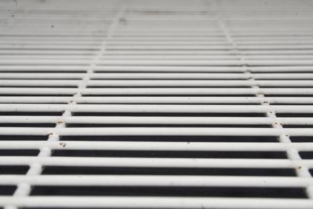 metal grill on black background 免版税图像
