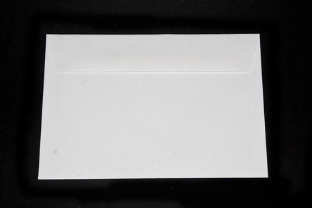 mail envelope isolated on black background Stock Photo
