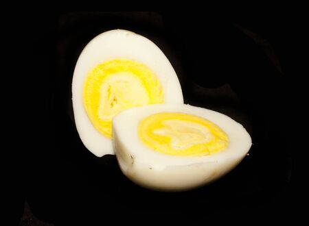 egg isolated on black background 写真素材