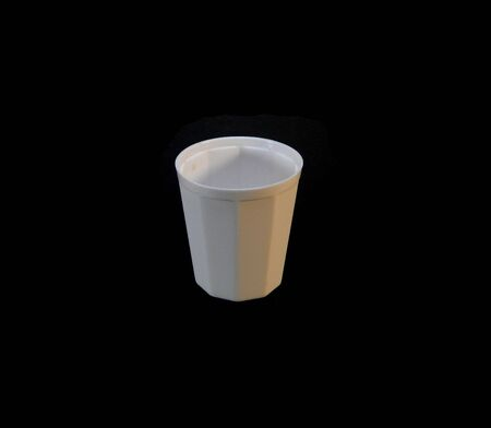 plastic cup isolated on black background
