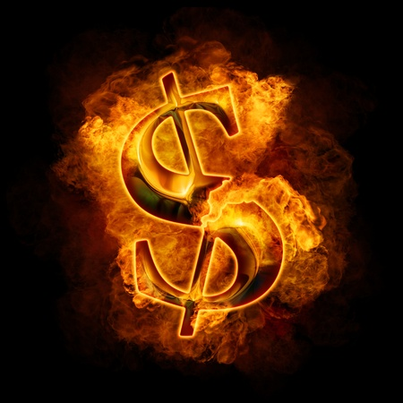 Financial crisis. Burning gold dollar photo