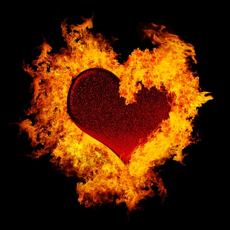 fire symbol: Abstract burning heart isolated on black background