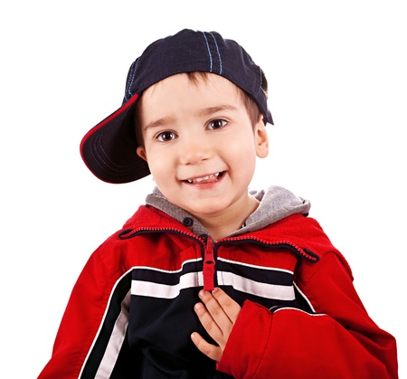 Little boy with cap on white background photo
