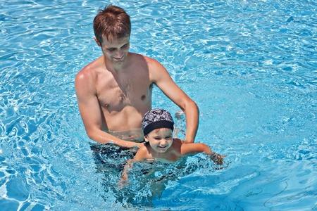 Father teaching his son to swim Stock Photo - 12083211
