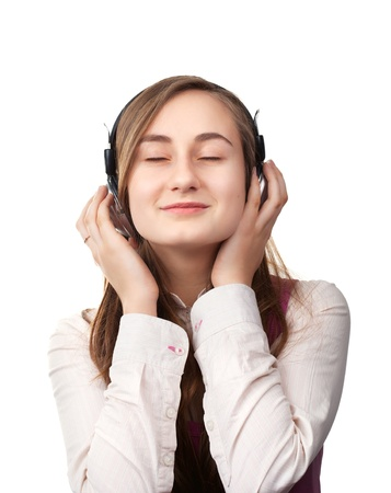 Girl listening to music in headphones  isolated on white background photo