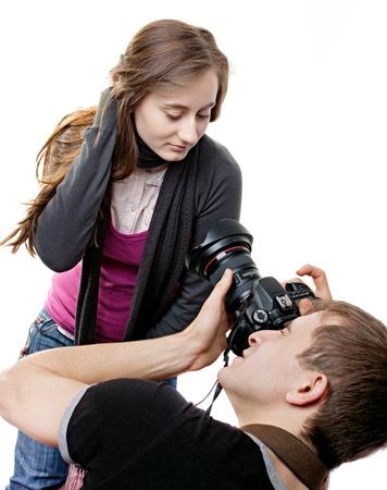 Photographer and model isolated on white background photo