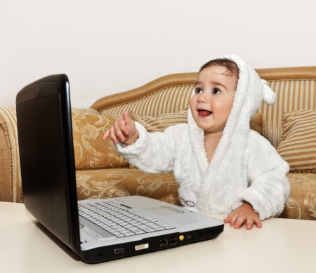 baby boy with laptop photo