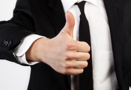 Businessman raised his thumb up, shows that all OK photo