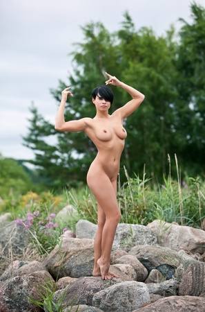 Young fully nude woman posing against nature background Stock Photo - 12419247