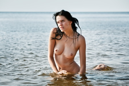 erotic breast: Beautiful naked woman standing in the water Stock Photo