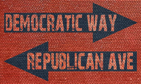 Election choice conceptual post with democratic way and republican ave on brick wall photo