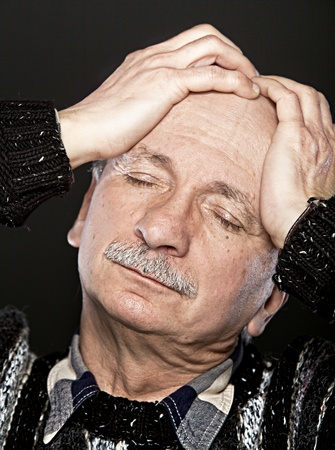 Depression. Elderly man suffering from a headache Stock Photo - 12723790