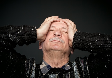 Depression. Elderly man suffering from a headache photo