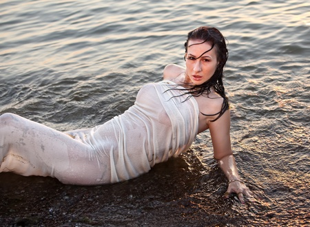 Portrait of a young girl lying in the sea Stock Photo - 13088228