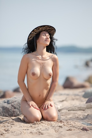 Portrait of topless woman in hat against blue sea Stock Photo - 13321951