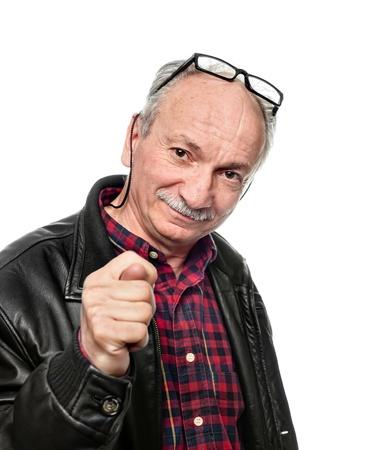 Senior man showing the fig. Emotional portrait isolated on white photo