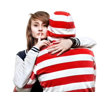 Portrait of a girl hugging a young man in the hood photo