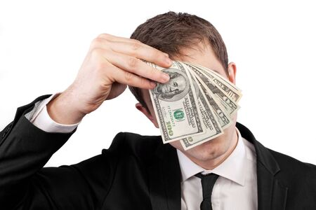 Businessman holding money with face behind dollars isolated on white photo