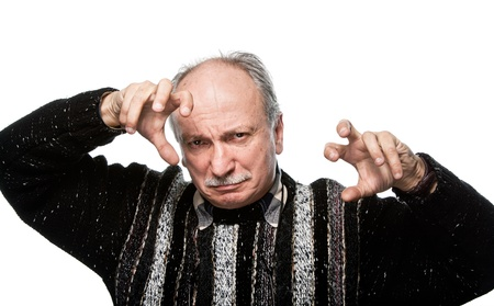 gesticulating offended elderly man with raised hands Stock Photo - 13639794