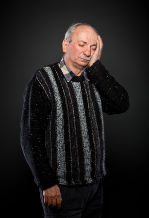 elderly man suffering from a toothache photo