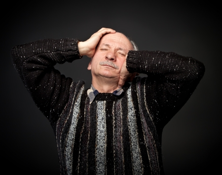 Elderly man suffering from a headache Stock Photo - 13652652