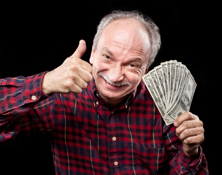 Happy elderly man showing fan of money and sign OK with fingers Stock Photo - 13719857