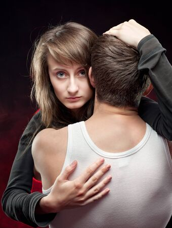 Portrait of a girl hugging a young man in a white T-shirt photo