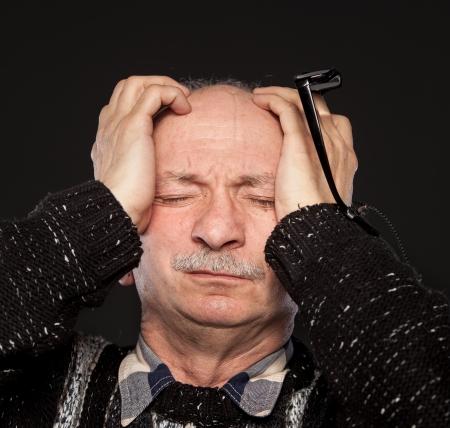 Elderly man suffering from a headache Stock Photo - 13843246