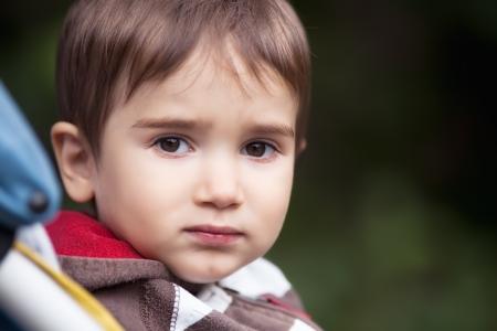 lonely child: Portrait of sad boy Stock Photo