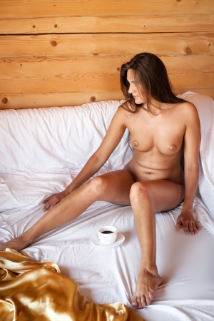 Young nude woman drinking coffee in bed in a camping Stock Photo - 14407615