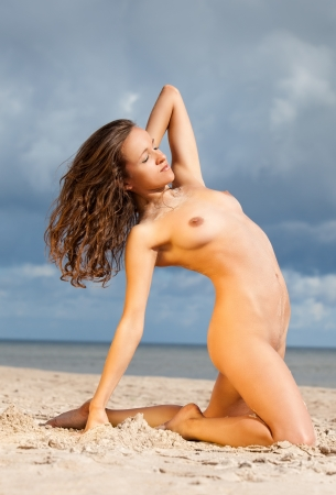 Young nude woman sunbathing on the beach Stock Photo - 14666024