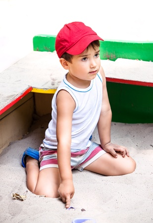 cool boy: Portrait of a  3-4 years boy playing on the playground Stock Photo