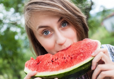 Young woman with watermelon outdoors Stock Photo - 14838898