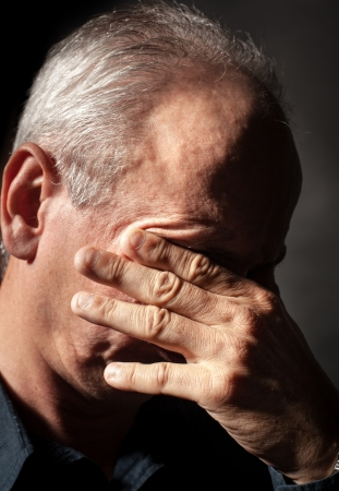one person only: Headache. Portrait of an elderly man with face closed by hand
