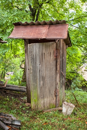 Rustic old wooden rural outside toilet  photo