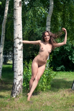 Beautiful nude woman near birch trees Stock Photo - 15782690