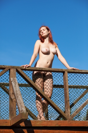 nude  girl on blue sky background