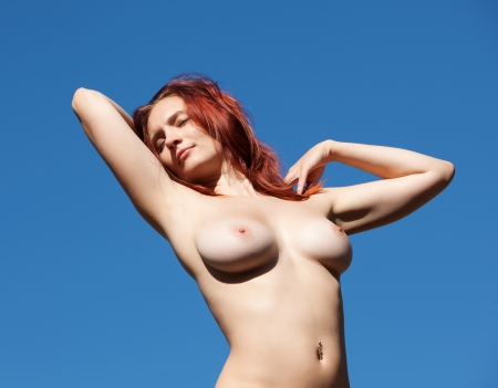 nude  girl on blue sky background Stock Photo - 15940756